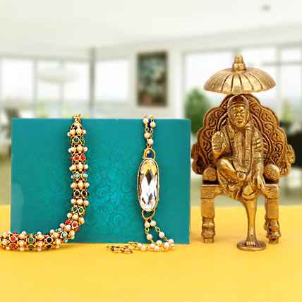 Golden Sai Baba With Rakhi